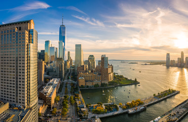 Fototapete - Aerial view of Lower Manhattan skyline at sunset viewed from above West Street in Tribeca neighborhood.