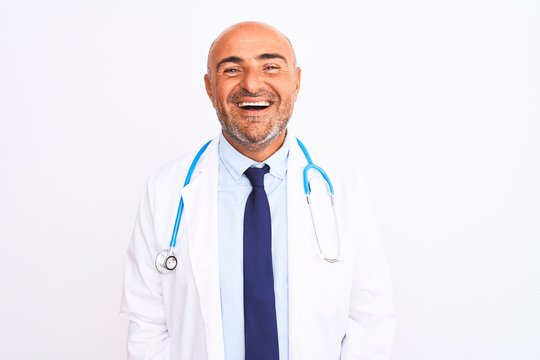 Middle age doctor man wearing stethoscope and tie standing over isolated white background with a happy and cool smile on face. Lucky person.