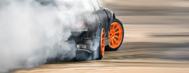 Race drift car burning tires on speed track