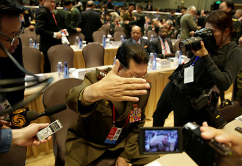 North Korea's Vice Minister of the People's Armed Forces Kim Hyong Ryong gestures to the media at the Xiangshan Forum in Beijing