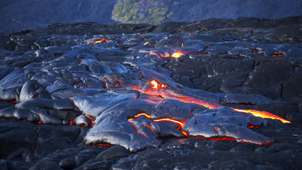 wide shot of a lava flow from kilauea volcano in hawaii
