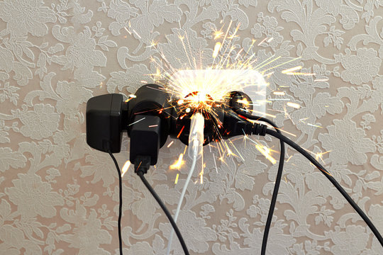 Overloaded socket, spark. Danger of electric shock, fire. Wire, plug, fire.