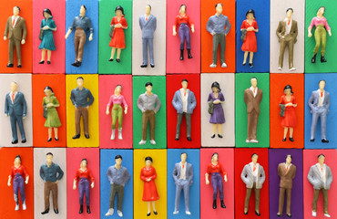 Obraz Concept background of people figures over colorful domino blocks. Idea of society and gender diversity - fototapety do salonu