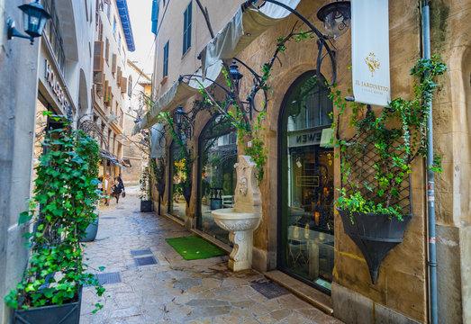 Majorca, Spain - January 8, 2019: Beautiful street at the historic city center of Palma de Majorca, Balearic Islands
