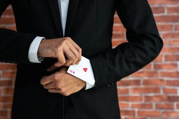 Business man with ace in his sleeve.,business goals concept,business growth,goals