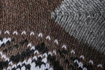 Fototapete - Knitted soft woolen sock as background, closeup