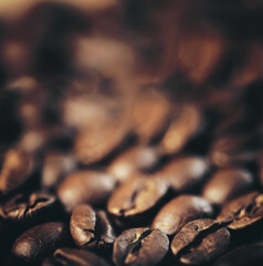 Coffee grains scattered on table