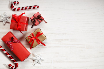 red gift boxes and decorations on Christmas table background.