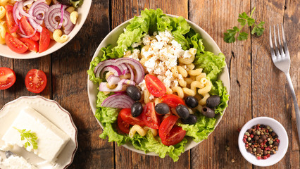 vegetable salad with pasta, olive, tomato, onion and feta