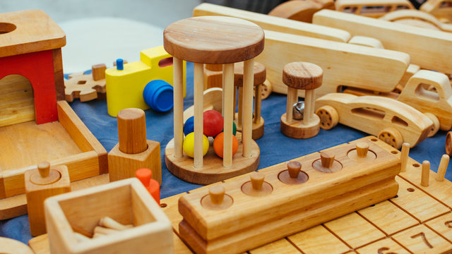 Creative eco wooden toys for baby und kids made of organic wood. Childrens Educational Eco-friendly wooden toys shop, store