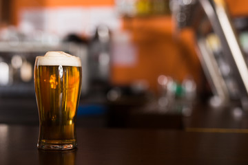 Image of light Beer in a traditional pint glass on table
