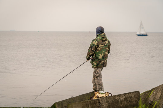 Man fishing from the pier