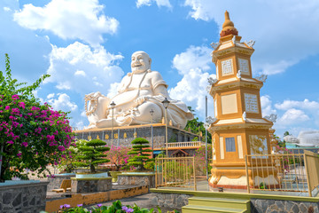 Architectural Specification biggest Maitreya Buddha merciful smile, bright white attracts many Buddhists to pray for peace. This is the beautiful architecture of Buddha in My Tho, Vietnam