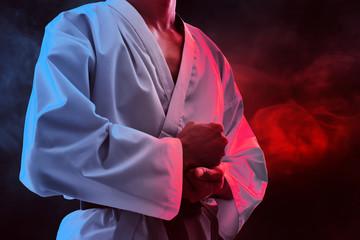Karate martial arts fighter on dark background