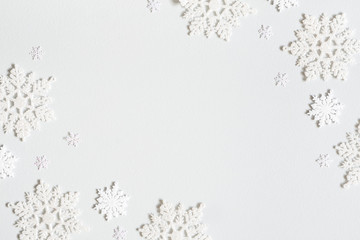 Christmas composition. Frame made of snowflakes on pastel gray background. Christmas, winter, new...