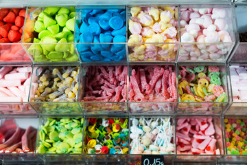 Variety of colored sweets on shelves