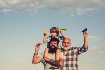 Happy man family have fun together. Weekend family play. Fathers day - grandfather, father and son are hugging and having fun together. Wall mural