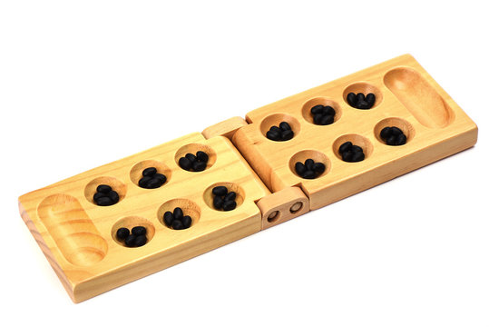 Stones and wooden folding board for playing mancala.