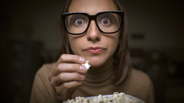 Woman with movies addiction