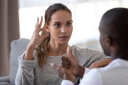Multiethnic disabled couple use sign language communicating
