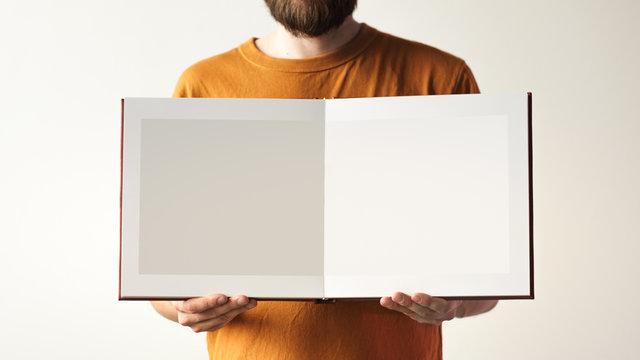 Mock up design templates. photo album in hand