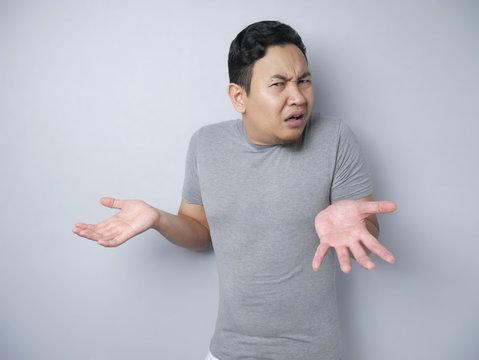Asian Man Shrug Shoulder I don't Know Gesture