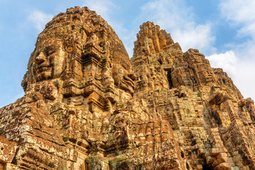 Wall Mural - Awesome bottom view of towers with stone faces, Bayon temple