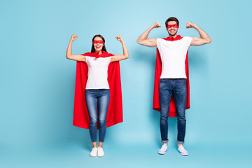 Full length body size view of nice attractive content cheerful sporty people wearing red hero look showing arm muscles ready to rescue isolated on bright vivid shine vibrant blue turquoise background