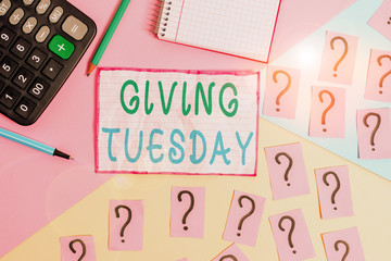 Handwriting text Giving Tuesday. Conceptual photo international day of charitable giving Hashtag activism Mathematics stuff and writing equipment above pastel colours background