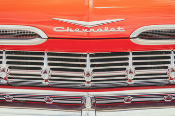 Classic red front of an old Chevrolet car in Den Bosch, The Netherlands on May 12, 2019