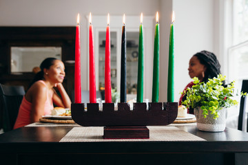 Selective focus of lighted Kwanzaa candles