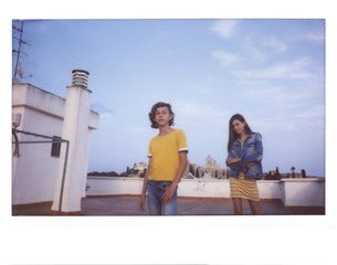 Couple of teens wandering on the roof.