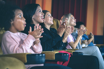 People applauding in the movie theater.