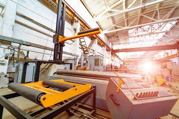 Production Wokshop interior. Metalworking machines in operation. Modern industrial enterprise.