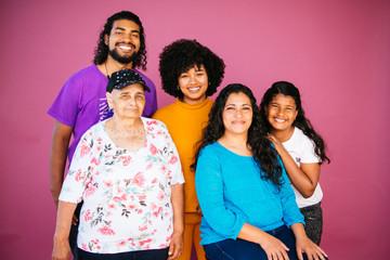 Family portrait of Latinx/Afrolatinx family in studio environment