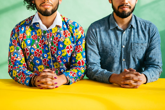 Portrait of Latino twin brothers in studio environment