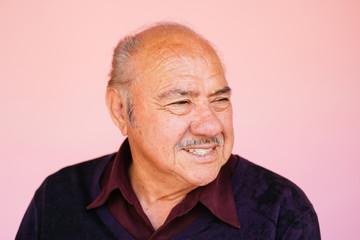 Portrait of eldery Latino grandfather in studio environment