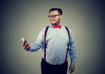 Funny chubby guy taking selfie with cell phone