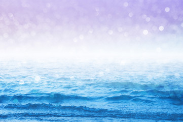 Pastel sea and sky images design with sparkling bokeh background