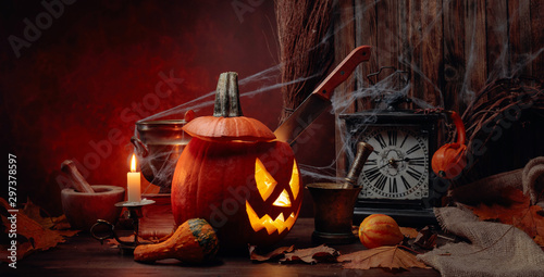 Halloween pumpkins on a old wooden background. Conceptual still life on the theme of Halloween.