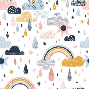 Vector sky seamless pattern with clouds, rain drops, rainbow, sun. Cute doodle decorative scandinavian print for textile, fabric, apparel gender-neutral kid nursery design