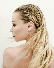 Back view of woman in loose hair turning aside