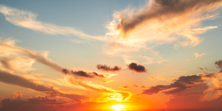 Dramatics orange and red sunset or sunrise sky with clouds for background