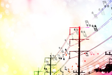 music notes on electric light cable with light colorful blurred background, the sound of music is everywhere concept