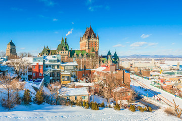 City Skyline of Old Quebec City with Chateau Frontenac, Dufferin terrace and St. Lawrence River in Winter