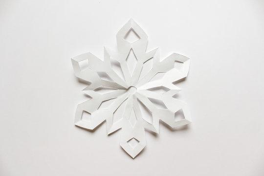 Large white snowflake on white backgound