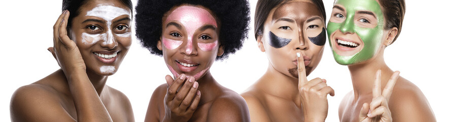 Beautiful multi-ethnic group of girls with colorful peel-off masks on their faces