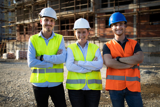 Group of construction workers on building site
