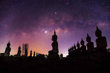Printed kitchen splashbacks Buddha Milky way galaxy with buddha stature landscape nature dark filter style
