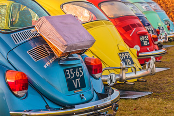 Row of vintage Volkswagen Beetles from the seventies  in Den Bosch, The Netherlands on January 4, 2015